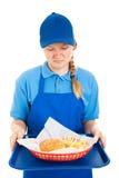 Trabajador adolescente asqueado por los alimentos de preparación rápida Fotografía de archivo libre de regalías