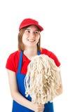 Trabajador adolescente en uniforme con la fregona Imagen de archivo libre de regalías