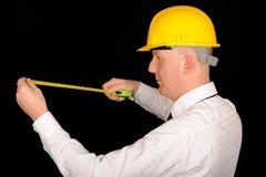 Trabajador con cinta métrica Foto de archivo libre de regalías