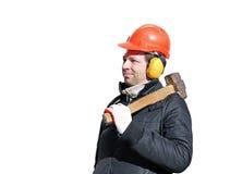 Trabajador con el martillo de trineo grande en el hombro aislado Foto de archivo libre de regalías