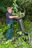 Trabajador con el schredder Foto de archivo libre de regalías