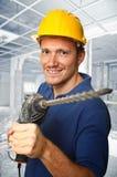 Trabajador con el taladro eléctrico Fotos de archivo