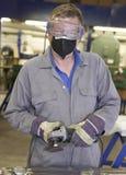 Trabajador con la amoladora de ángulo Foto de archivo libre de regalías