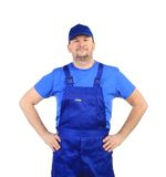Trabajador con los brazos en la cintura. Imagenes de archivo