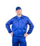 Trabajador con los brazos en la cintura Imágenes de archivo libres de regalías