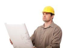 Trabajador con planes Imagenes de archivo