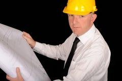 Trabajador con planes Imagen de archivo libre de regalías