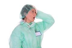 Trabajador dado una sacudida eléctrica de grito del cuidado médico Foto de archivo libre de regalías