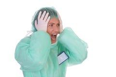 Trabajador dado una sacudida eléctrica de grito del cuidado médico Imagen de archivo libre de regalías