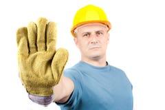 Trabajador de collar azul que hace la muestra de la parada Foto de archivo