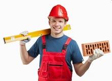 Trabajador de construcción alegre en uniforme Fotografía de archivo libre de regalías