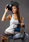 Trabajador de construcción atractivo de la mujer joven imagen de archivo libre de regalías