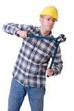 Trabajador de construcción con el cortador de tornillo imagen de archivo libre de regalías