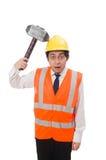 Trabajador de construcción con el martillo aislado en fotografía de archivo libre de regalías