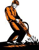 Trabajador de construcción con el martillo perforador Fotografía de archivo libre de regalías