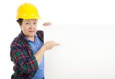 Trabajador de construcción con el mensaje Fotos de archivo
