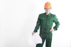 Trabajador de construcción con el modelo a disposición Imágenes de archivo libres de regalías