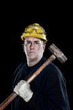 Trabajador de construcción con la almádena Imagenes de archivo