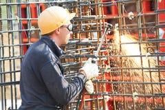 Trabajador de construcción con la llama Fotos de archivo