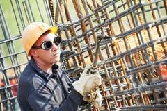 Trabajador de construcción con la llama Imagenes de archivo
