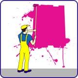 Trabajador de construcción con la pintura en la pared Imagenes de archivo
