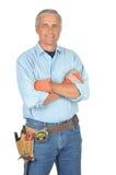 Trabajador de construcción con los brazos plegables Fotos de archivo libres de regalías