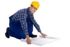 Trabajador de construcción con los modelos Fotografía de archivo libre de regalías