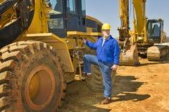 Trabajador de construcción de la carretera con el equipo Imagen de archivo libre de regalías