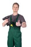 Trabajador de construcción de sexo masculino con destornillador eléctrico Fotografía de archivo libre de regalías