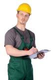 Trabajador de construcción de sexo masculino con las notas Imágenes de archivo libres de regalías