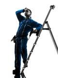 Trabajador de construcción del hombre cansado sudando la silueta Foto de archivo