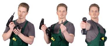 Trabajador de construcción del hombre con destornillador eléctrico Foto de archivo libre de regalías