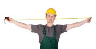 Trabajador de construcción del hombre con la cinta de la regla Imagen de archivo