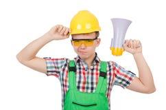 Trabajador de construcción divertido con el altavoz Imagen de archivo libre de regalías