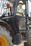 Trabajador de construcción Driving Digger fotos de archivo libres de regalías