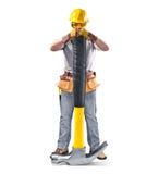 Trabajador de construcción en casco con la herramienta y el martillo Imagen de archivo