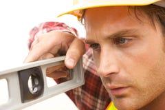 Trabajador de construcción en el trabajo Imágenes de archivo libres de regalías
