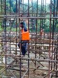 Trabajador de construcción en la India foto de archivo