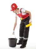 Trabajador de construcción en uniforme con el rodillo Fotografía de archivo libre de regalías