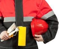 Trabajador de construcción en uniforme con las herramientas Fotografía de archivo