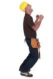 Trabajador de construcción encantado Foto de archivo libre de regalías