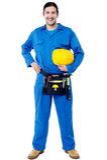 Trabajador de construcción joven sonriente Imágenes de archivo libres de regalías