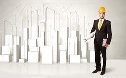 Trabajador de construcción que acepilla con los edificios 3d en fondo Foto de archivo