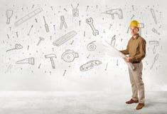 Trabajador de construcción que acepilla con los iconos dibujados mano de la herramienta Foto de archivo libre de regalías