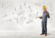 Trabajador de construcción que acepilla con los iconos dibujados mano de la herramienta Foto de archivo