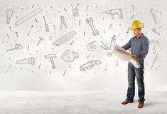 Trabajador de construcción que acepilla con los iconos dibujados mano de la herramienta Fotos de archivo