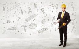 Trabajador de construcción que acepilla con los iconos dibujados mano de la herramienta Fotos de archivo libres de regalías