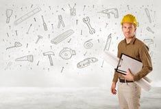Trabajador de construcción que acepilla con los iconos dibujados mano de la herramienta Fotografía de archivo libre de regalías
