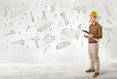 Trabajador de construcción que acepilla con los iconos dibujados mano de la herramienta Imagen de archivo libre de regalías