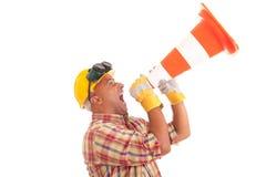 Trabajador de construcción que grita Imagenes de archivo